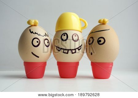 Eggs With Painted Face. Concept Of Business