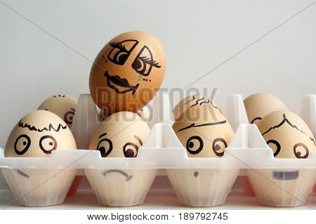 Eggs With A Painted Face In Two Rows