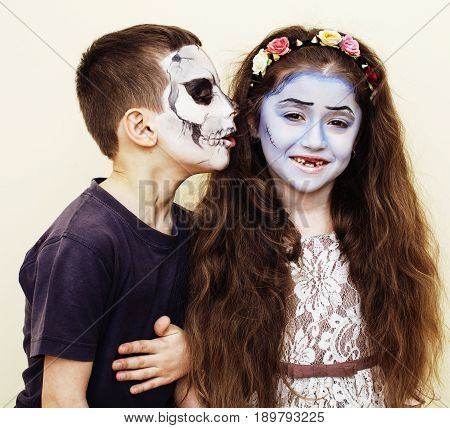 zombie apocalypse real kids concept. Birthday party celebration facepaint on children dead bride, scar face, zombie skeleton together close up makeup emotional posing.