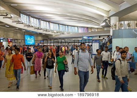 NEW DELHI, INDIA - APRIL 5, 2017: People inside the new metro station in New Delhi India on the 5th of april 2017