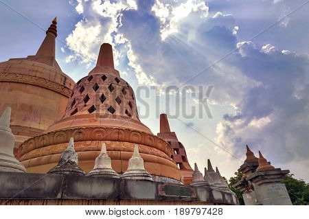 Sunrays Shining Through Clouds Above Chedi Hin Sai, A Huge Complex Of Sandstone Stupas Resembling Bo