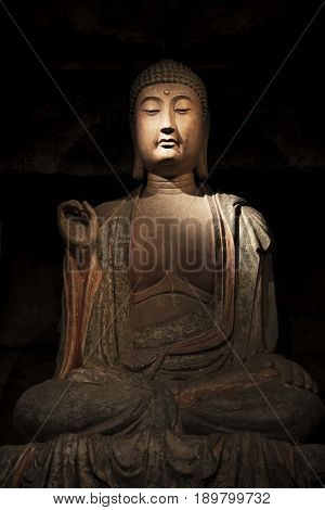 Stone Buddha and relics from the Zhongshan Grottoes in Zichang County displayed at the Shaanxi History Museum in Xian Shaanxi Province in China