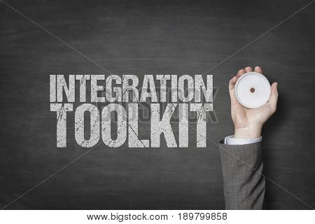 Integration toolkit text with businessman hand holding cogwheel