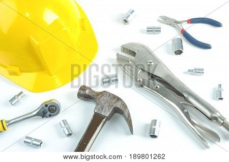 Flat lay of repairman work safety helmet adjustable wrench socket wrench set hammer cutter