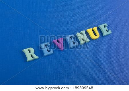 HOME word on blue background composed from colorful abc alphabet block wooden letters, copy space for ad text. Learning english concept