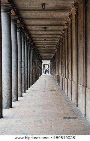 Copenhage Denmark - August 10 2016. Urban arcade with columns in Copenhagen city centre. Disminishing perspective