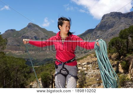 Female Climber On The Peak Folding Rope
