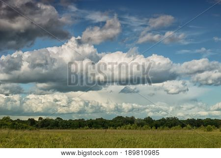 Beautiful Cumulus Clouds Over The Green Valley