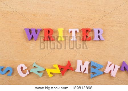 word on wooden background composed from colorful abc alphabet block wooden letters, copy space for ad text. Learning english concept.