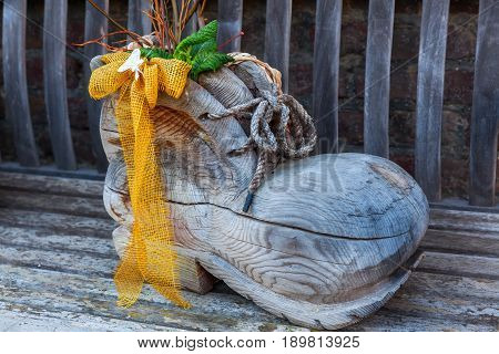 Clog As Decoration On A Wooden Bench