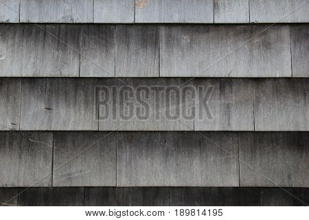 Background of old, weathered, wood shingles on beach house