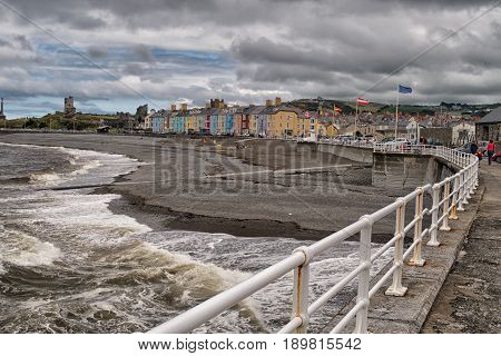 Aberysthwyth Sea Front On A Stormy Day With Brightly Painted Houses