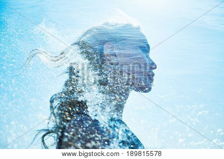 Summer portrait of a girl in blue sea waves. Beautiful blonde on the background of the sea summer vacation at sea. A mysterious girl in sea foam