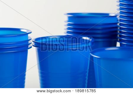 blue disposable plastic glasses isolated on white