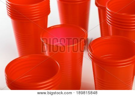 red disposable plastic glasses isolated on white
