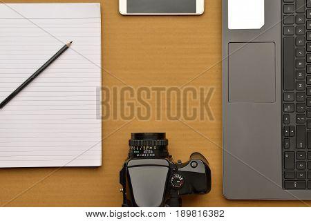 Photographers equipment shot in studio on brown background