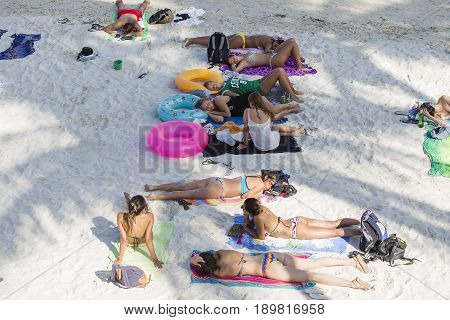 KOH PHANGAN THAILAND - NOVEMBER 15 2016 : Haad Rin beach before the full moon party. Unidentified people arrived on the island of Koh Phangan to participate in the Full Moon party