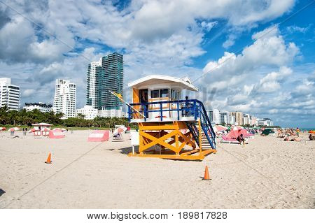 Open Wooden Tower With Lifeguard Man Patrolling Sea Beach