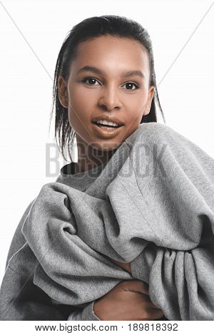 Close-up Portrait Of Beautiful African American Girl In Grey Sweater Smiling At Camera