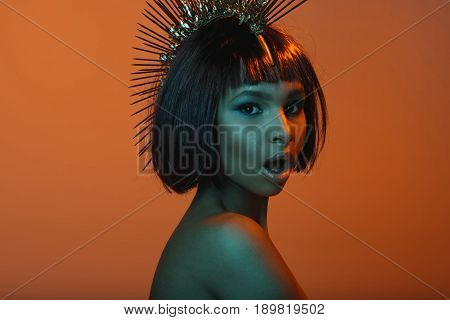 Stylish African American Woman In Headpiece With Facial Expression