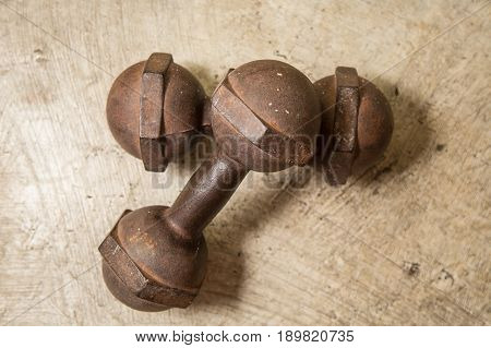 Dumbbell dirty vintage on floor  image closeup