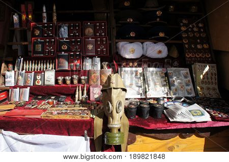 MOSCOW, RUSSIA - MAY 2, 2017: Soviet and Russian military paraphernalia and symbolism at the flea market: flasks, cups, medals, gas masks, medals, caps, emblems and other
