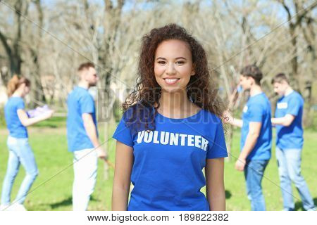 Beautiful African American volunteer outdoors