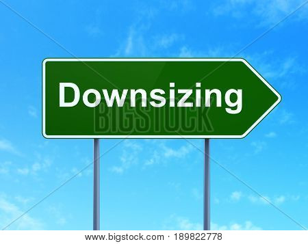 Business concept: Downsizing on green road highway sign, clear blue sky background, 3D rendering