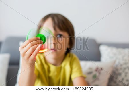 Little Child, Boy, Playing With Green Luminous Fidget