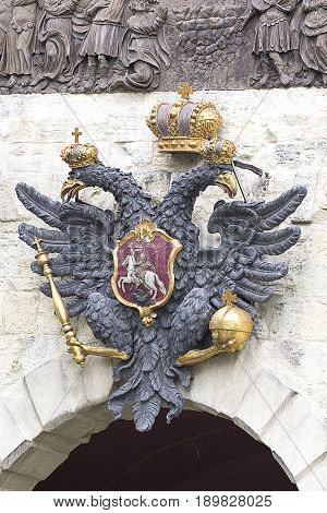 two-headed eagle, a symbol of autocratic power. Established in St. Petersburg at the gates of the Peter and Paul Fortress