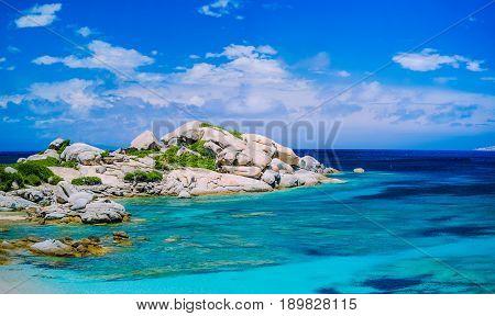 Bizarre granite rocks formation in amazing azure water on beautiful Sardinia island near Porto Pollo, Sargedna, Italy.