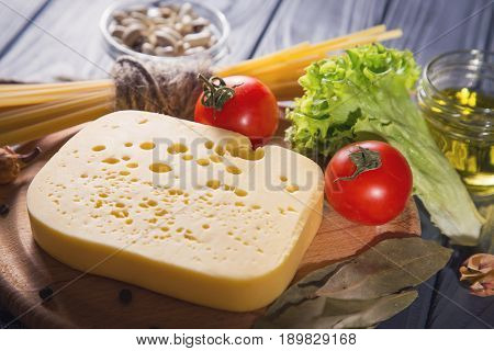 assortment of food-macaroni,chees,eoil and vegetables in studio