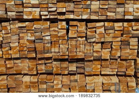 Stack Of Teak Wood In Lumber Yard. Pile Wooden