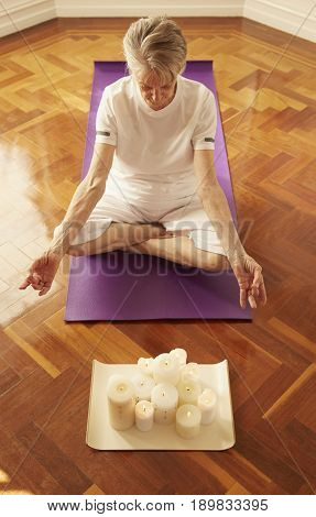 Older Caucasian woman meditating