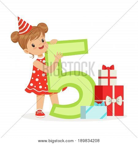 Cute happy five year old girl in a red party hat celebrating her birthday, colorful cartoon character vector Illustration isolated on a white background