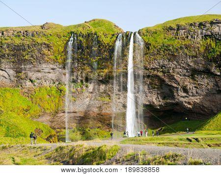 Seljaland Waterfall, aka Seljalandsfoss, front view on sunny day in Iceland