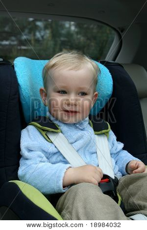 18 months old baby boy in car safety seat. poster