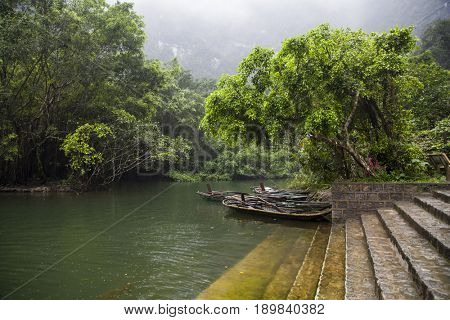 Traditional boats on the river in Tam Coc,Vietnam. Vietnam travel landscape and destinations background.