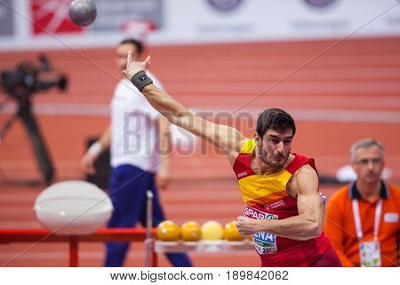 BELGRADE SERBIA - MARCH 3-5 2017: MAN HEPTATHLON SHOT PUT URENA JORGE EUROPEAN ATHLETICS INDOOR CHAMPIONSHIPS IN BELGRADE SERBIA