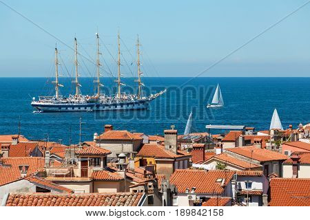 The world's largest sailing ship with five masts anchored in the open sea near old city Piran Slovenia.