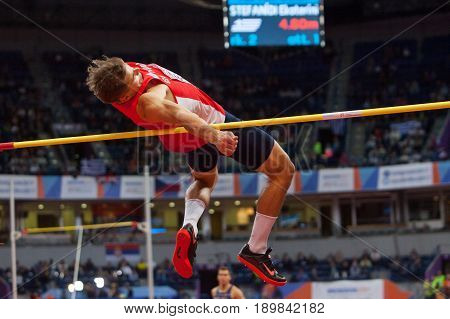 BELGRADE SERBIA - MARCH 3-5 2017: MAN HEPTATHLON HIGH JUMP HELCELET ADAM SEBASTIAN EUROPEAN ATHLETICS INDOOR CHAMPIONSHIPS IN BELGRADE SERBIA