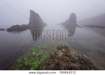 Magnificent seascape over the rock phenomenon The Ships, Sinemorets village, Bulgaria. Foggy weather.