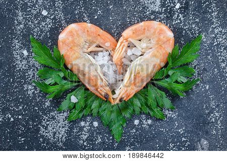 Raw Prawns, Shrimps With Hearts With Condiments On A Stone Background, Strewn With Sea Salt And Herb
