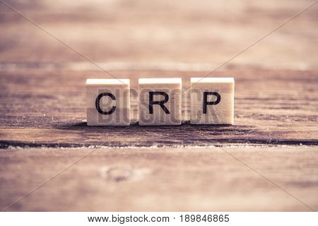 Cost recovery price abbreviation collected of wooden elements with the letters
