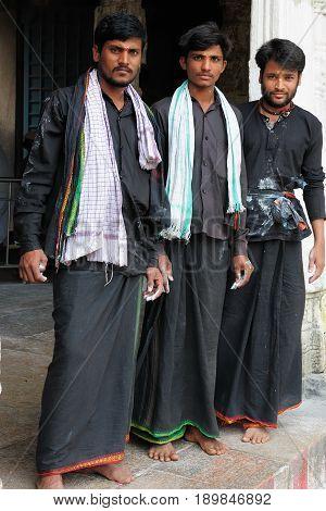MADURAJ TAMILNADU INDIA - 08 JANUARY 2010: Indian pilgrims standing ahead of the temple in the Maduraj town in India