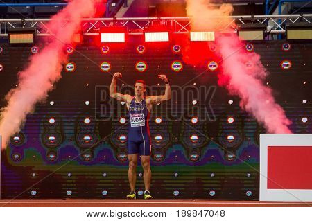 BELGRADE SERBIA - MARCH 3-5 2017: MAN HEPTATHLON 60M HURDLES DUDAS MIHAIL EUROPEAN ATHLETICS INDOOR CHAMPIONSHIPS IN BELGRADE SERBIA