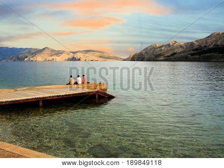 jetty and sundown on the island Prvic, from Baska beach, Croatia