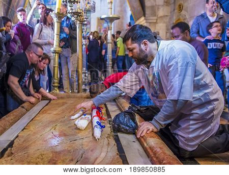 JERUSALEM - APRIL 13 : Pilgrims prays during Easter in the church of the holy sepulcher in Jerusalem Israel on April 13 2017