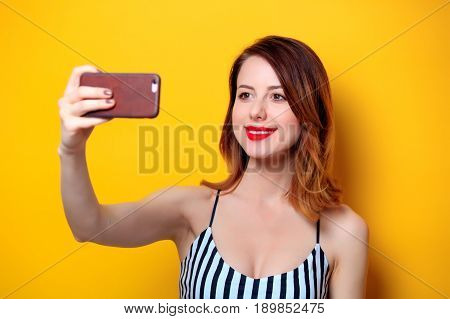 Woman Making Selfie On Yellow Background