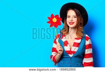 Smiling Woman With Red Pinwheel